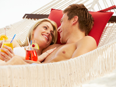 AUTH-Couple-in-Hammock-with-Tropical-Drinks